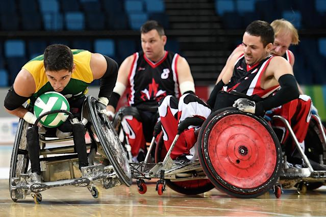 RIO DE JANEIRO, BRAZIL - FEBRUARY 26: Julio Cesar Braz of Brazil competes against Patrice Dagenais of Canada during the International Wheelchair Rugby Championship - Aquece Rio Test Event for the Rio 2016 Paralympics match between Brazil and Canada at Olympic Park on February 26, 2016 in Rio de Janeiro, Brazil. (Photo by Buda Mendes/Getty Images)