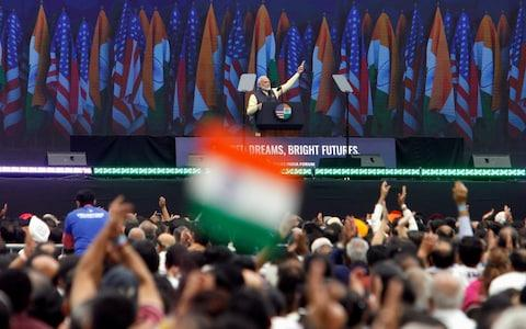 The Indian prime minister received a hero's welcome on the eve of the summit at a 'Howdy, Modi' rally in Texas, where he was accompanied by Donald Trump - Credit: Daniel Kramer/Reuters