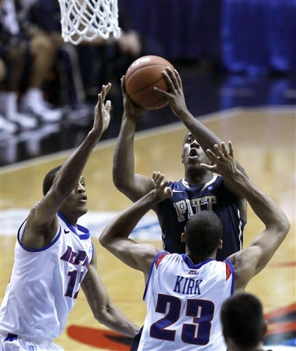 Pittsburgh guard Lamar Patterson, center, shoots over the defense of DePaul's forward Cleveland Melvin, left, and Donnavan Kirk, during the first half of a Big East NCAA college basketball game on Thursday, Jan. 5, 2012 in Rosemont, Ill. (AP Photo/Charles Rex Arbogast)