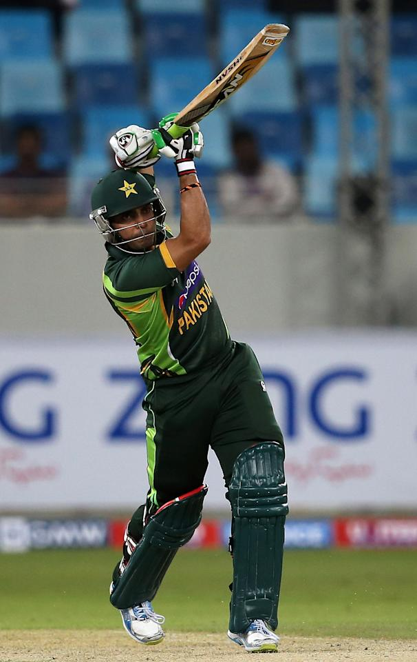 DUBAI, UNITED ARAB EMIRATES - DECEMBER 11:  Umar Akmal of Pakistan bats during the first Twenty20 International match between Pakistan and Sri Lanka at Dubai Sports City Cricket Stadium on December 11, 2013 in Dubai, United Arab Emirates.  (Photo by Francois Nel/Getty Images)