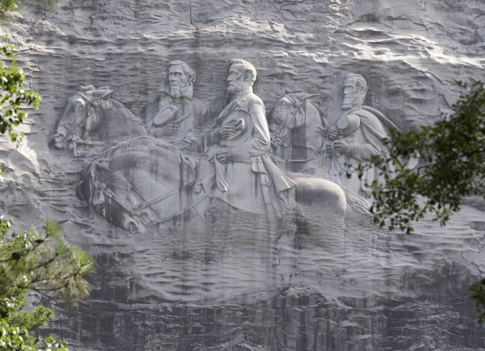 A carving depicting Confederateicons Stonewall Jackson, Robert E. Lee and Jefferson Davis, in Stone Mountain, Ga.