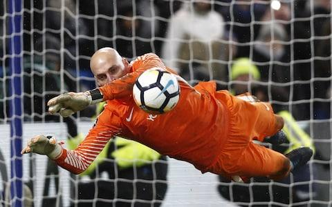 Chelsea's Argentinian goalkeeper Willy Caballero saves the penalty from Norwich City's Portuguese striker Nelson Oliveira - Credit: AFP/Getty