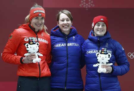 Skeleton - Pyeongchang 2018 Winter Olympics – Women's Finals - Olympic Sliding Center - Pyeongchang, South Korea – February 17, 2018 - Jacqueline Loelling of Germany, Lizzy Yarnold of Britain and Laura Deas of Britain on the podium. REUTERS/Edgar Su