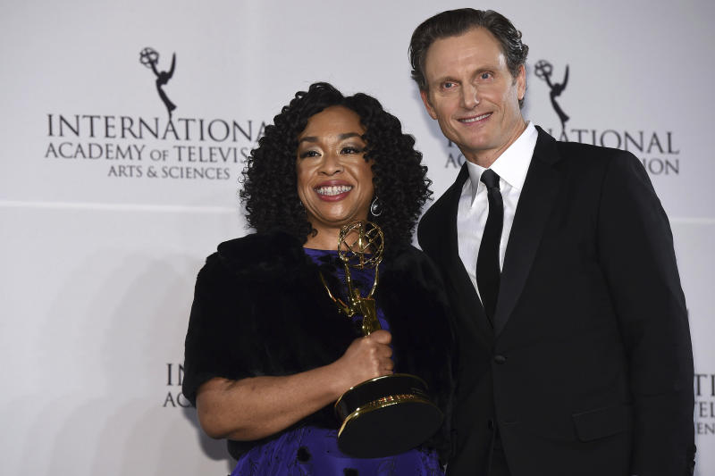 Shonda Rhimes, left, winner of the Founders Award and presenter Tony Goldwyn appear in the press room for the 44th International Emmy Awards at the New York Hilton on Monday, Nov. 21, 2016, in New York. (Photo by Charles Sykes/Invision/AP)