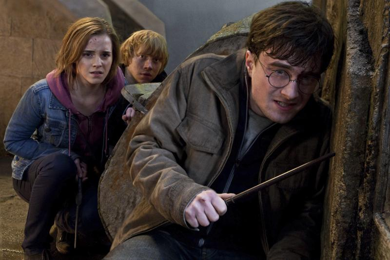 """FILE-   In this file film publicity image released by Warner Bros. Pictures, from left, Emma Watson, Rupert Grint and Daniel Radcliffe are shown in a scene from """"Harry Potter and the Deathly Hallows: Part 2.""""   (AP Photo/Warner Bros. Pictures, Jaap Buitendijk, File)"""