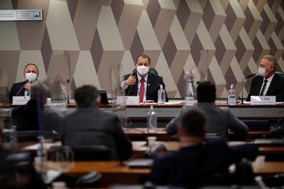 Former Brazil's Health Minister Eduardo Pazuello, Brazilian Senator Renan Calheiros and Brazilian Senator Omar attend a meeting of the Parliamentary Inquiry Committee (CPI) to investigate government actions and management during the coronavirus disease (COVID-19) pandemic, at the Federal Senate in Brasilia, Brazil May 19, 2021. REUTERS/Adriano Machado