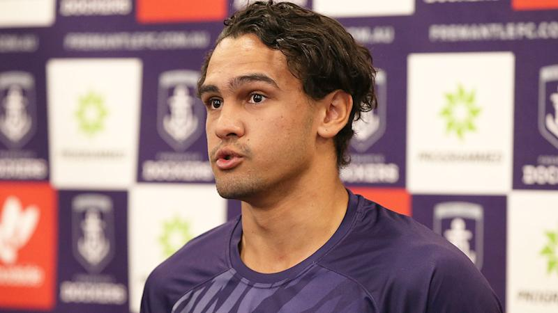 Pictured here, Jason Carter speaks during a Fremantle Dockers press conference.