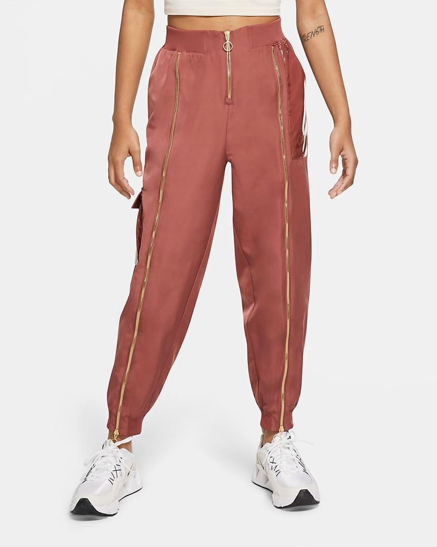 "<br><br><strong>Nike</strong> Woven Pants, $, available at <a href=""https://go.skimresources.com/?id=30283X879131&url=https%3A%2F%2Fwww.nike.com%2Ft%2Fsportswear-icon-clash-womens-woven-pants-nfMw9X%2FCU6925-652"" rel=""nofollow noopener"" target=""_blank"" data-ylk=""slk:Nike"" class=""link rapid-noclick-resp"">Nike</a>"