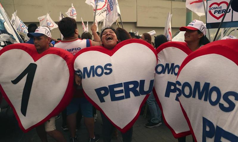 Supporters of congressional candidates gather outside the location of the candidates' debate in Lima on Sunday.