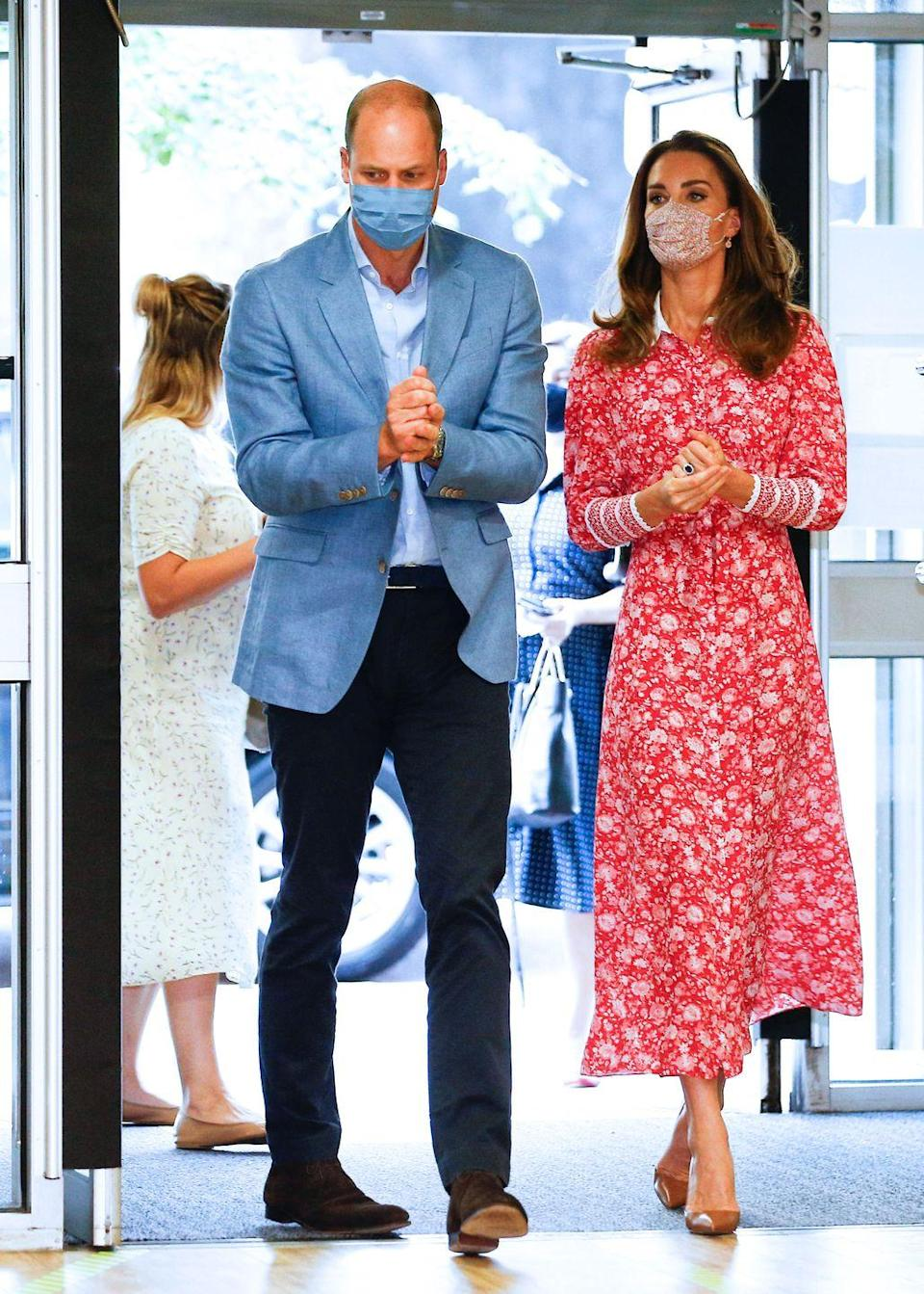 """<p>The Duke and Duchess of Cambridge <a href=""""https://www.townandcountrymag.com/society/tradition/a34026114/prince-william-kate-middleton-london-back-to-work-photos/"""" rel=""""nofollow noopener"""" target=""""_blank"""" data-ylk=""""slk:spent the day in London"""" class=""""link rapid-noclick-resp"""">spent the day in London</a>, visiting communities hit hard by the coronavirus pandemic. Kate ushered in fall with a red floral shirtdress, brown pumps, and her frequently-worn Liberty-print face mask from the boutique, <a href=""""https://www.amaiakids.co.uk/collections/adult-masks"""" rel=""""nofollow noopener"""" target=""""_blank"""" data-ylk=""""slk:Amaia"""" class=""""link rapid-noclick-resp"""">Amaia</a>. </p>"""