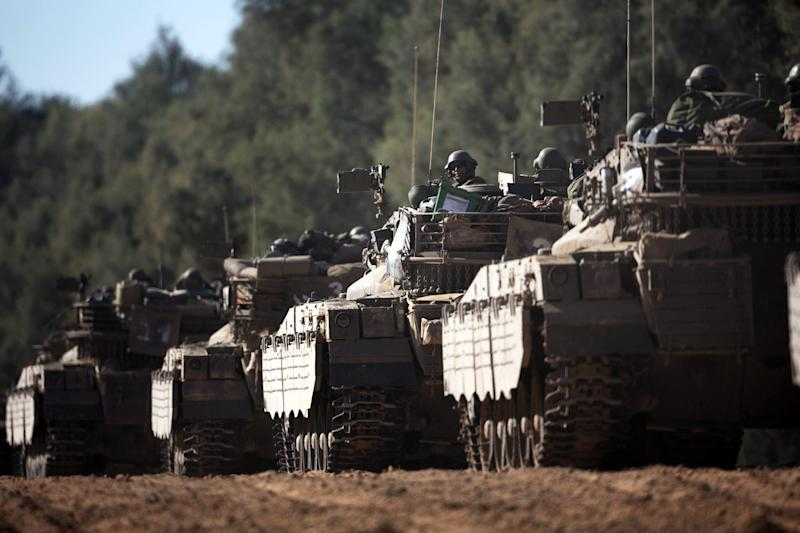 A convoy of Israeli Merkava tanks near Israel's border with the Gaza Strip on July 11, 2014