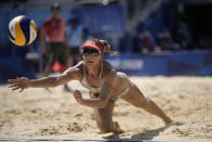 Heather Bansley, of Canada, dives for the ball during a women's beach volleyball match against the United States at the 2020 Summer Olympics, Sunday, Aug. 1, 2021, in Tokyo, Japan. (AP Photo/Felipe Dana)