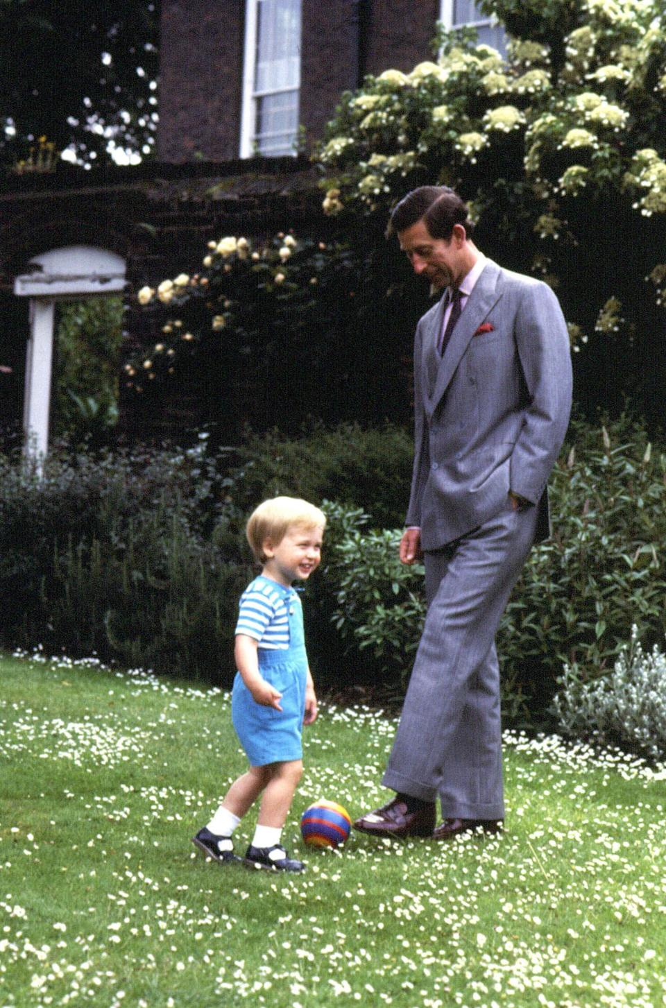 <p>Charles and Prince William playing in the garden of Kensington Palace, London, in 1984 (PA) </p>