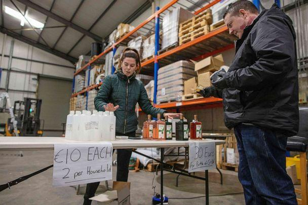 PHOTO: Members of the public queue to buy bottles of hand sanitizer and gin, made and sold at Listoke Distillery and Gin School in Tenure, north of Dublin in Ireland, March 18, 2020. (Paul Faith/AFP via Getty Images)
