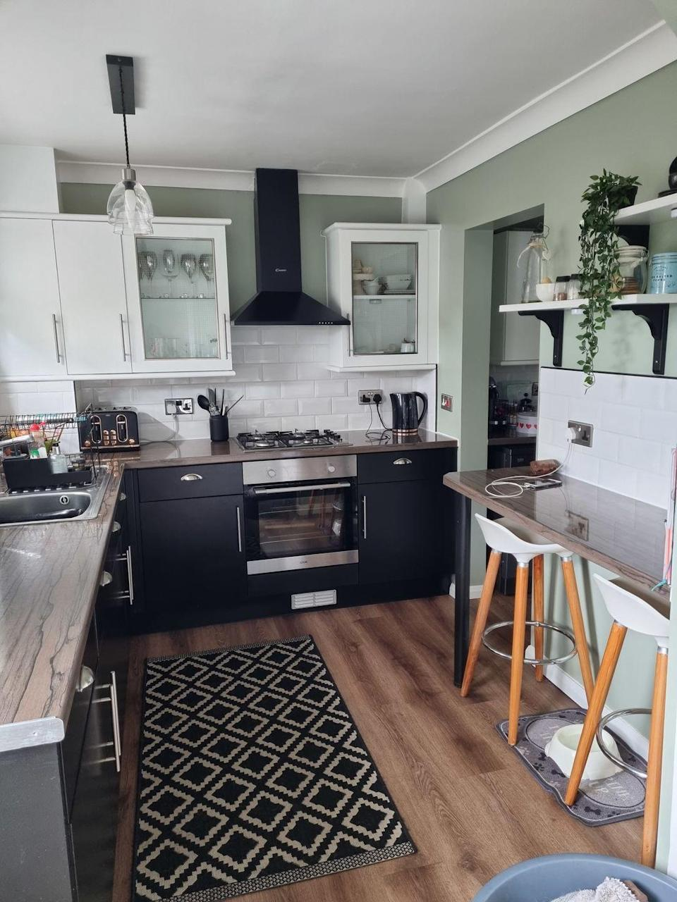 <p>It looks completely new! We're crushing on the dark-hued cabinets, which add a grown-up feel to the space. </p>