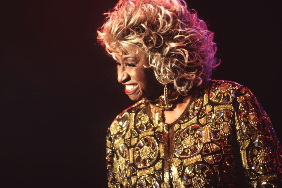 """<p><em>¡Azúcar!</em> If you know the catchphrase, it's from the late Latin star, Celia Cruz. From her start as a vocalist in the musical group Sonora Matancera, Cruz mastered a variety genres of music styles, from Guaracha to rumba to afro to son and bolero. She left her home in Cuba to pursue her music career, releasing hits like """"Quimbara"""" """"La vida es un carnaval"""" and """"La negra tiene tumbao"""". She helped popularize Latin music in the United States, earning the nickname The Queen of Salsa. Her career also included guest starring roles in <em><a href=""""https://www.amazon.com/Mambo-Kings-Armand-Assante/dp/B001QVMU4Q/?tag=syn-yahoo-20&ascsubtag=%5Bartid%7C10063.g.37563312%5Bsrc%7Cyahoo-us"""" rel=""""nofollow noopener"""" target=""""_blank"""" data-ylk=""""slk:The Mambo Kings"""" class=""""link rapid-noclick-resp"""">The Mambo Kings</a> </em>and many telenovelas. With all she has done for the Latin community, let's explore the Queen of Latin Music: Celia Cruz. </p>"""