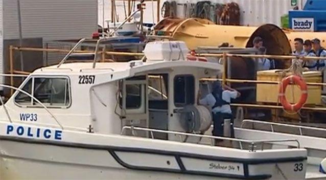 Water Police raced out to the barge. Picture: 7 News