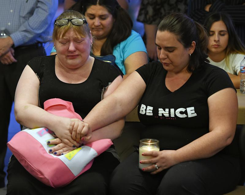 <strong>Heidi Antonacci (L) and her daughter Jessica Adsit, both of Nevada, attend a prayer vigil held at Mountain Crest Park for the victims of Sunday night's shooting</strong>