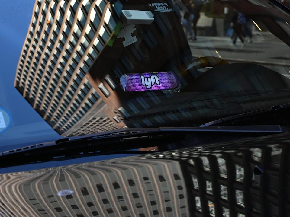 A Lyft ride-sharing car is seen on 42nd Street in New York on March 26, 2019. - Lyft Inc.'s initial public offering is expected to have its (IPO) this week making it the first of the ride-hailing companies to open up to the public. (Photo by TIMOTHY A. CLARY / AFP)        (Photo credit should read TIMOTHY A. CLARY/AFP/Getty Images)