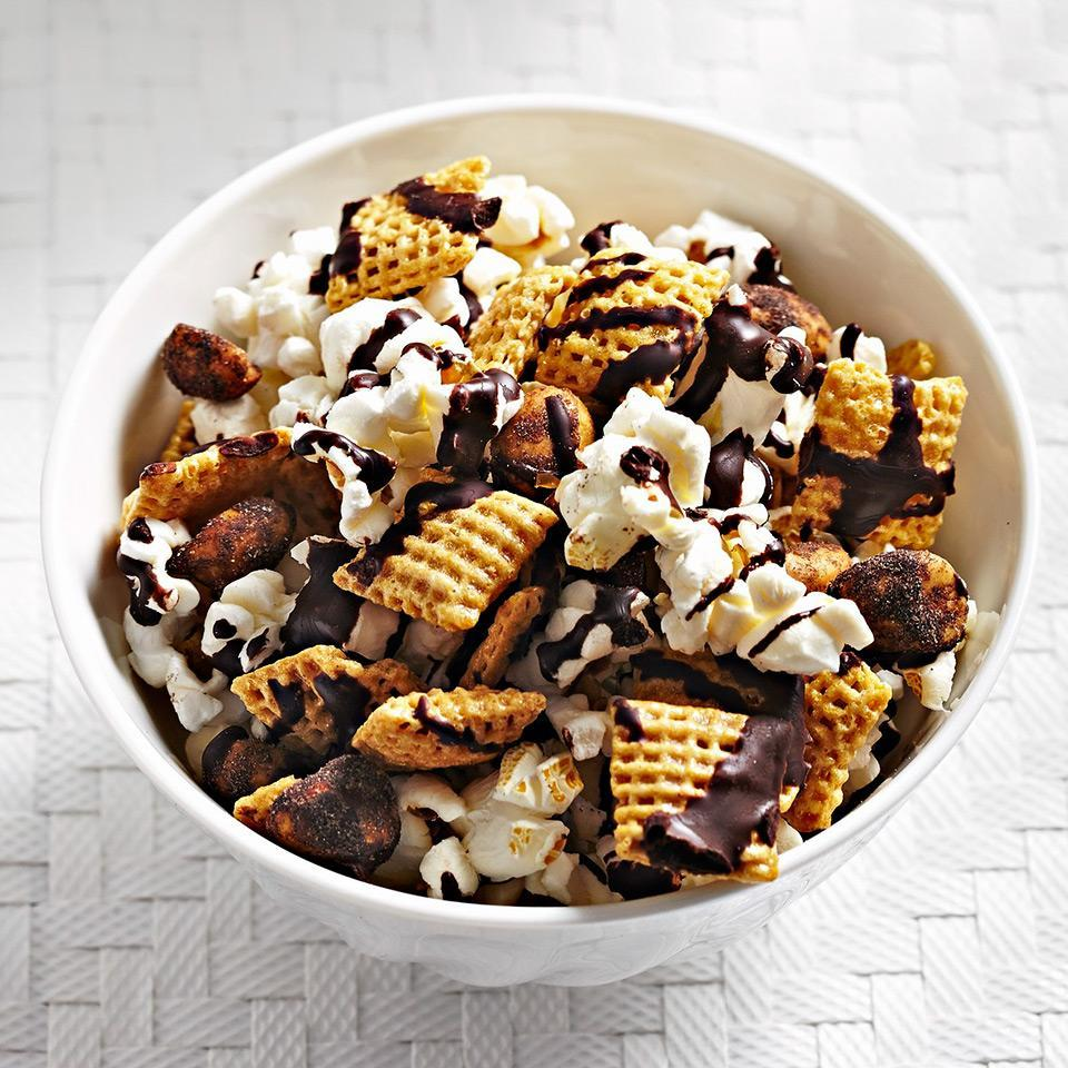 <p>This sweet and savory popcorn mix is ready in just 10 minutes and is a bit of a magic trick--it's so good it disappears right before your eyes! Honey-nut cereal squares, lightly-salted popcorn, and chocolaty peanuts are drizzled with melted chocolate and provide amazing taste in each bite.</p>
