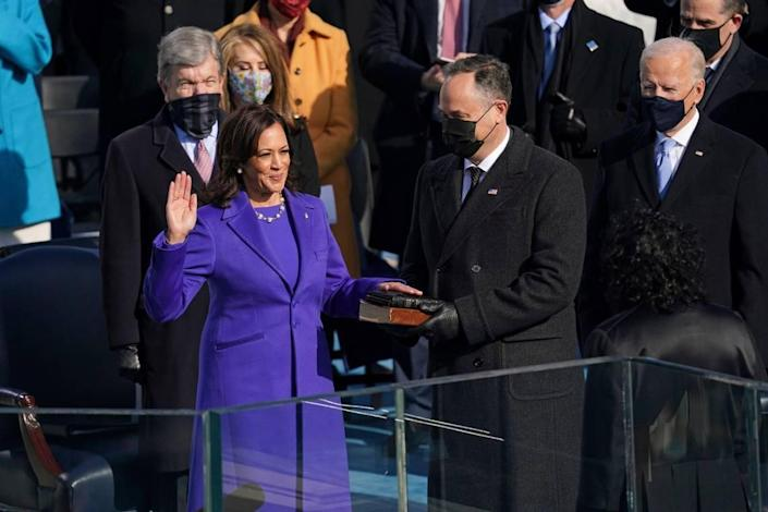 Kamala Harris is sworn in as vice president of the United States by Supreme Court Justice Sonia Sotomayor as her husband Doug Emhoff holds the Bible during the 59th Presidential Inauguration at the U.S. Capitol in Washington, Wednesday, Jan. 20, 2021.