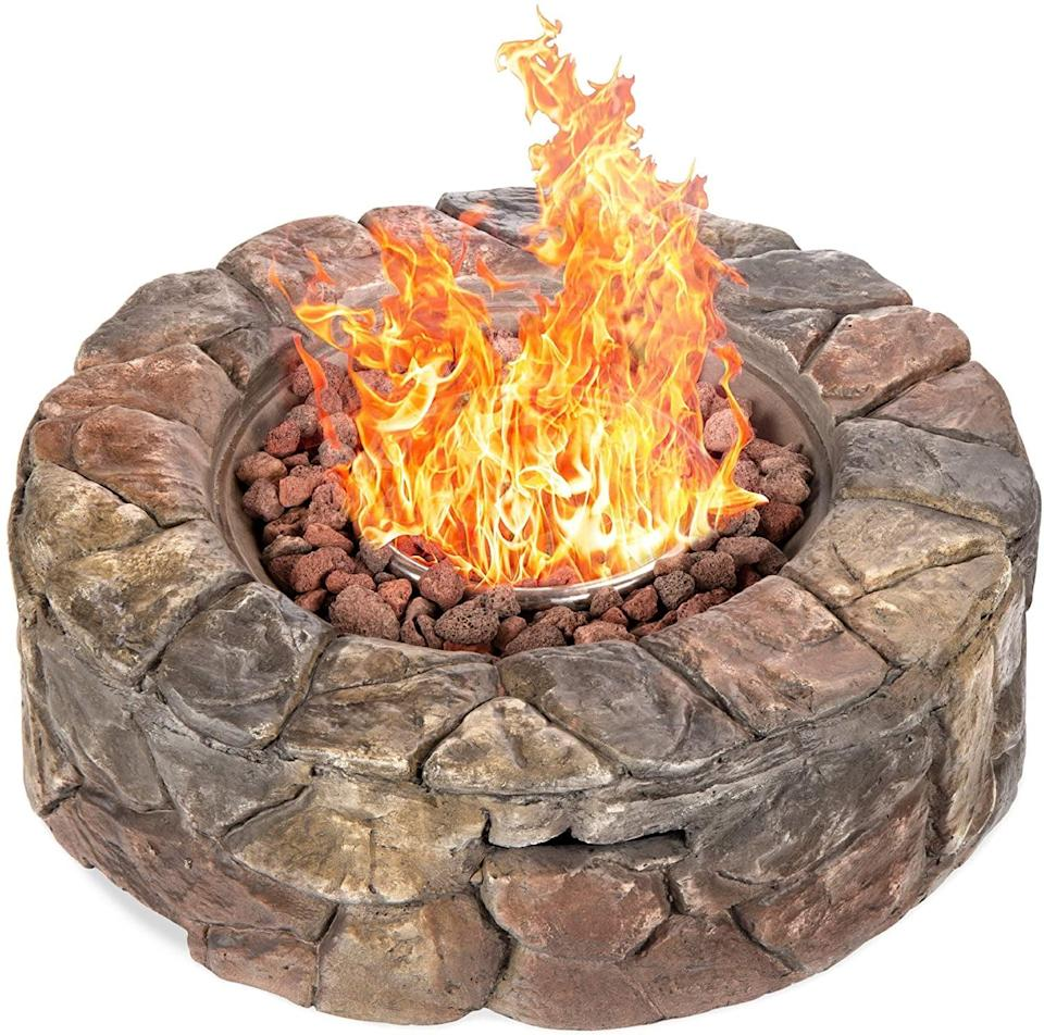 <p>Add a natural element to your backyard with this <span>Best Choice Products Gas Fire Pit With Natural Stone</span> ($220).</p>