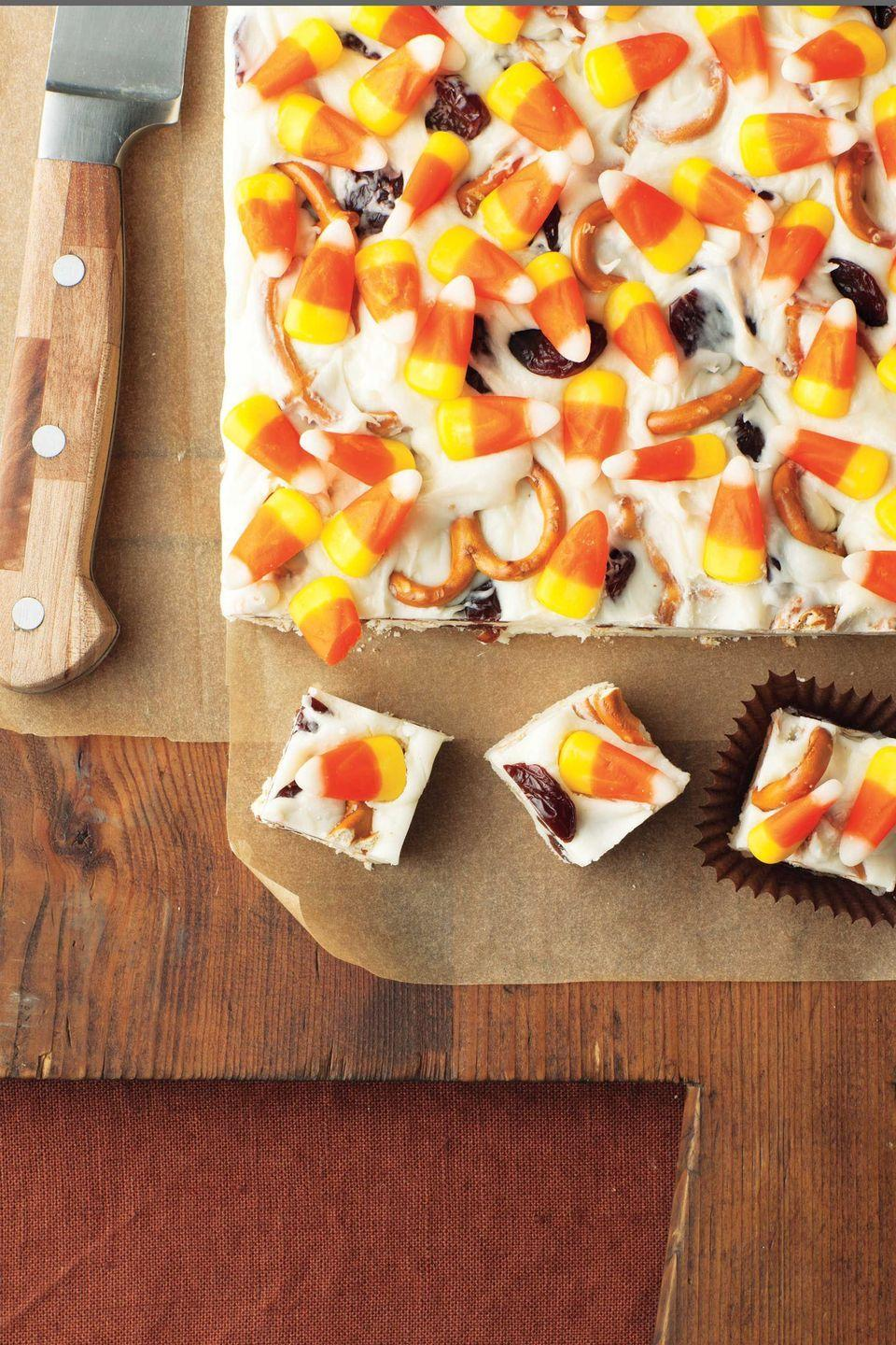 """<p>These colorful treats may sound super sweet, but a few key ingredients keep them balanced: cream cheese for tanginess, pretzels for a salty kick, and dried cherries for a touch of tartness. </p><p><strong><em><a href=""""https://www.womansday.com/food-recipes/food-drinks/recipes/a11819/candy-corn-fudge-recipe-123647/"""" rel=""""nofollow noopener"""" target=""""_blank"""" data-ylk=""""slk:Get the Candy Corn Fudge recipe."""" class=""""link rapid-noclick-resp"""">Get the Candy Corn Fudge recipe. </a></em></strong></p><p><strong>What You'll Need: </strong><a href=""""https://www.amazon.com/Jelly-Belly-Gourmet-Candy-Ounce/dp/B00AYGEFAQ?tag=syn-yahoo-20&ascsubtag=%5Bartid%7C10070.g.1289%5Bsrc%7Cyahoo-us"""" rel=""""nofollow noopener"""" target=""""_blank"""" data-ylk=""""slk:Jelly Belly Gourmet Candy Corn"""" class=""""link rapid-noclick-resp"""">Jelly Belly Gourmet Candy Corn</a> ($10, Amazon)</p>"""
