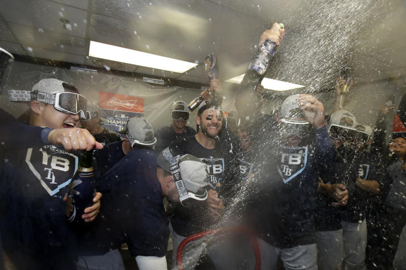 Tampa Bay Rays players celebrate after defeating the Oakland Athletics in an American League wild-card baseball game in Oakland, Calif., Wednesday, Oct. 2, 2019. (AP Photo/Jeff Chiu)