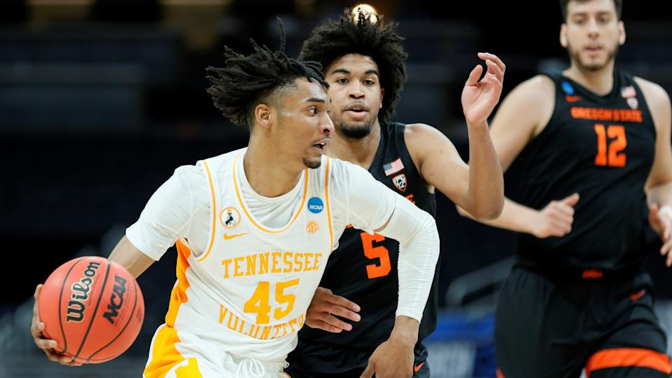 INDIANAPOLIS, INDIANA - MARCH 19: Keon Johnson #45 of the Tennessee Volunteers drives the ball as Ethan Thompson #5 of the Oregon State Beavers tries to defend during the first half in the first round game of the 2021 NCAA Men's Basketball Tournament at Bankers Life Fieldhouse on March 19, 2021 in Indianapolis, Indiana. (Photo by Sarah Stier/Getty Images) ORG XMIT: 775630318 ORIG FILE ID: 1307992527