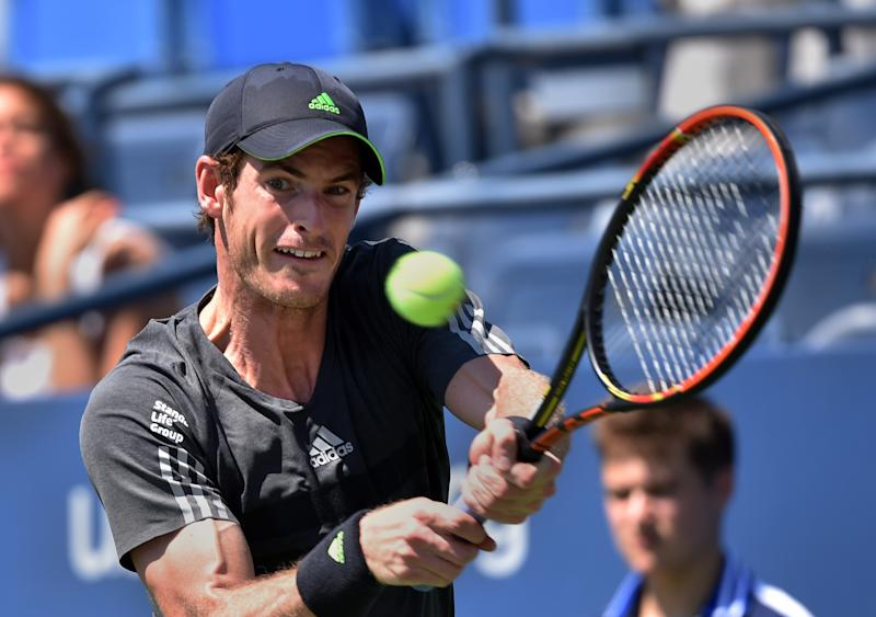 Andy Murray of Britain returns a shot to Robin Haase of the Netherlands during their 2014 US Open men's singles match at the USTA Billie Jean King National Tennis Center August 25, 2014 in New York