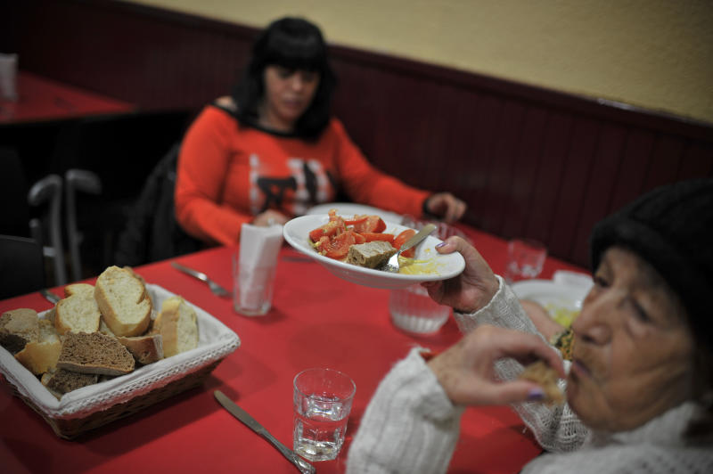 Two women have dinner at a free meal centre in Pamplona, northern Spain, Thursday, March 1, 2012. Spain already has the highest unemployment rate in the 17-nation eurozone with more than five millions unemployed and more than eleven million people poor and at risk of social exclusion, as the economic crisis continues. (AP Photo/Alvaro Barrientos)