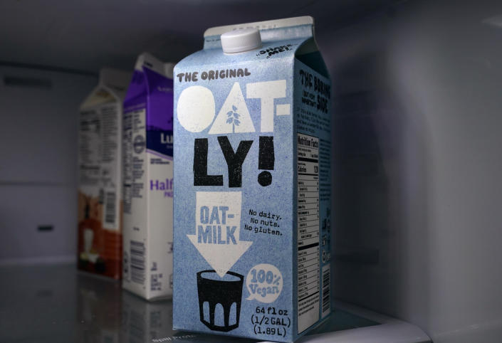 A carton of Oatly oat milk sits in a home refrigerator Tuesday, May 18, 2021, in Bellingham, Wash. Oatly, the world's largest oat milk company, will raise $1.4 billion in an initial public offering Thursday, May 20 on the Nasdaq stock exchange. (AP Photo/Elaine Thompson)