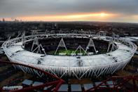 LONDON, ENGLAND - JULY 27: The sun sets over the Olympic Stadium prior to the Opening Ceremony for the 2012 Olympic Games on July 27, 2012 at Olympic Park in London, England. (Photo by Jamie Squire/Getty Images)