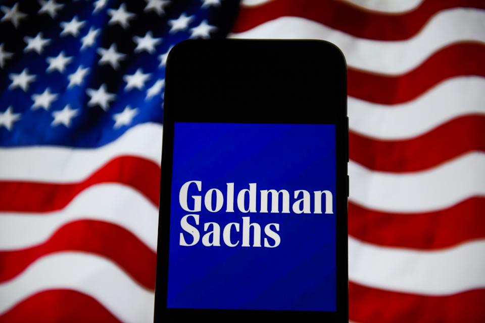 POLAND - 2020/02/23: In this photo illustration a Goldman Sachs seen displayed on a smartphone with the United States of America flag on the background. (Photo Illustration by Omar Marques/SOPA Images/LightRocket via Getty Images)