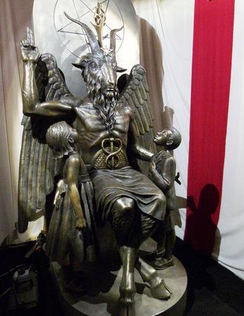 FILE PHOTO: A one-ton, 7-foot (2.13-m) bronze statue of Baphomet -- a goat-headed winged deity that has been associated with satanism and the occult -- is displayed by the Satanic Temple during its opening in Salem, Massachusetts, U.S. September 22, 2016.  REUTERS/Ted Siefer/File Photo