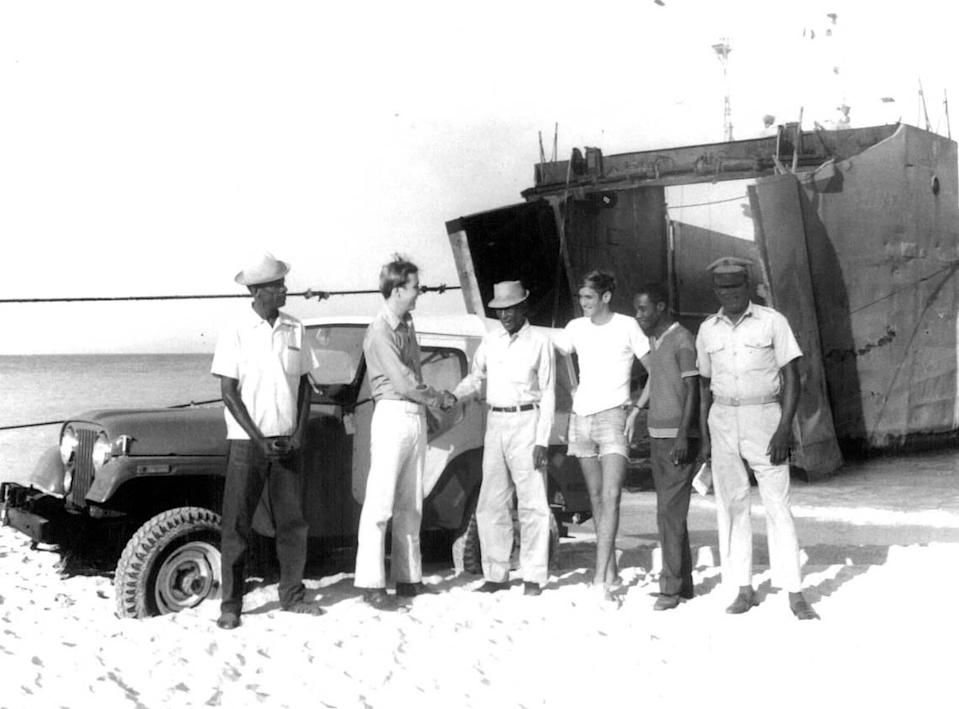 Grey Pierson, second from left, visits Haiti's Île de la Tortue or Tortuga Island in 1972, a year after his father's 99-year-lease with the Haitian government to develop the barrier island was published in the government's official newspaper.