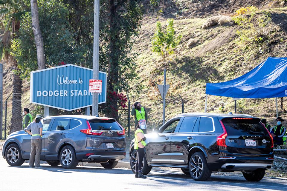 LOS ANGELES, CA - JANUARY 15: CORE employees direct traffic at Dodger Stadium  in Los Angeles after it was turned into a COVID-19 drive-thru vaccination site on Friday, January 15, 2021. (Photo by Sarah Reingewirtz, Los Angeles Daily News/SCNG)