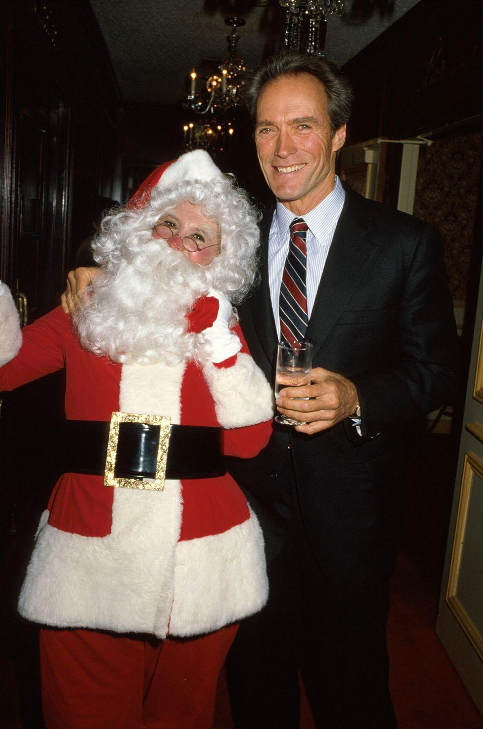 <p>While attending a Christmas party in Los Angeles, Clint Eastwood posed for a photo with Santa (comedian Dinah Shore) and rocked a red, gold and navy tie. </p>