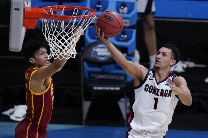 Gonzaga guard Jalen Suggs (1) shoots ahead of Southern California forward Max Agbonkpolo, left, during the second half of an Elite 8 game in the NCAA men's college basketball tournament at Lucas Oil Stadium, Tuesday, March 30, 2021, in Indianapolis. (AP Photo/Darron Cummings)