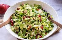 """<p>This colorful salad is guaranteed to brighten up your dinner table. Shaved Brussels sprouts, chopped pear, pomegranate seeds and crumbled blue cheese are tossed together for this boldly flavorful salad.</p> <p><a href=""""https://www.thedailymeal.com/recipes/brussels-sprout-salad-pear-and-pomegranate-recipe?referrer=yahoo&category=beauty_food&include_utm=1&utm_medium=referral&utm_source=yahoo&utm_campaign=feed"""" rel=""""nofollow noopener"""" target=""""_blank"""" data-ylk=""""slk:For the Brussels Sprout Salad With Pear and Pomegranate recipe, click here."""" class=""""link rapid-noclick-resp"""">For the Brussels Sprout Salad With Pear and Pomegranate recipe, click here.</a></p>"""