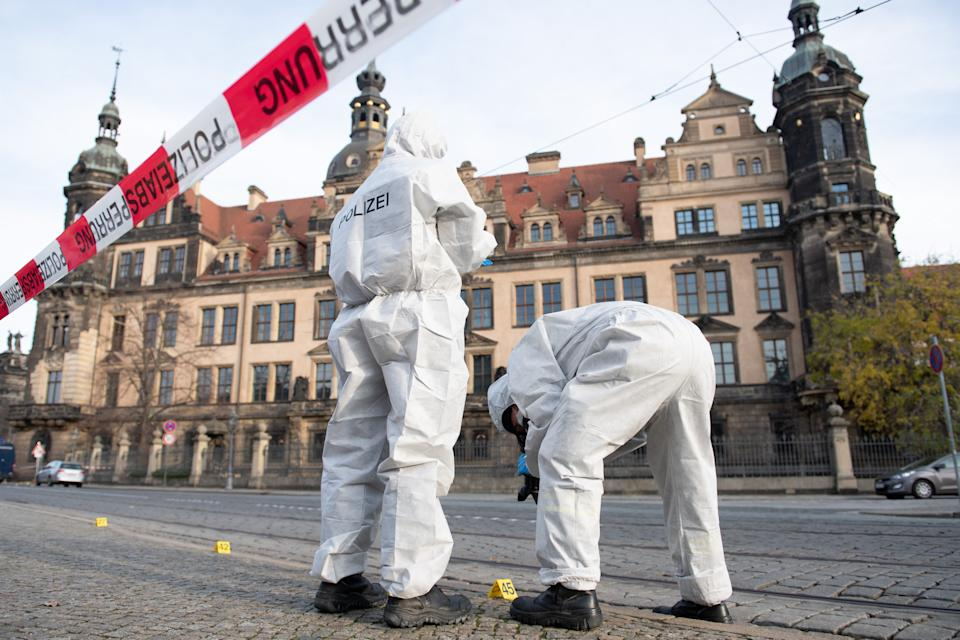 25 November 2019, Saxony, Dresden: Two members of the forensic team are standing in front of the Residence Palace with the Green Vault behind a barrier tape. Dresden's Treasury Green Vault was broken into early in the morning. The break-in affects the historical part of the valuable collection. Photo: Sebastian Kahnert/dpa-Zentralbild/dpa (Photo by Sebastian Kahnert/picture alliance via Getty Images)