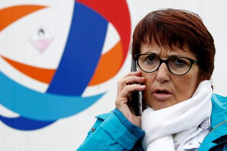FILE PHOTO: Christiane Lambert, President of France's farmer's union group FNSEA, makes a phone call as she stands in front journalists during a protest by French farmers near the French oil giant Total refinery in Donges, France, June 11, 2018. REUTERS/Stephane Mahe