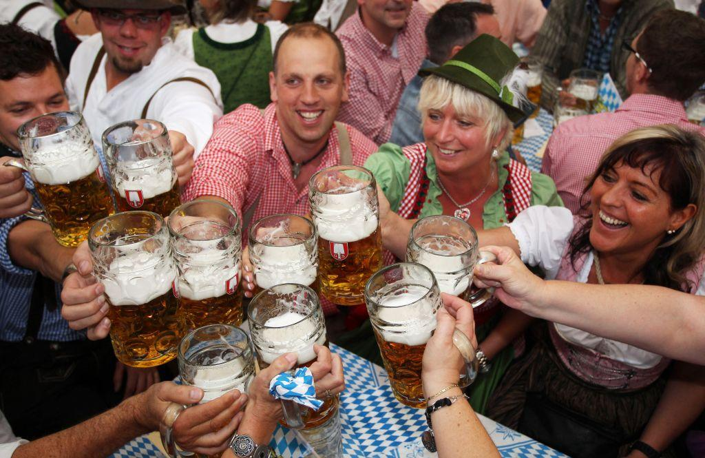 Visitors toast with beer mugs at a beer tent during the opening day of the Oktoberfest 2012 beer festival.