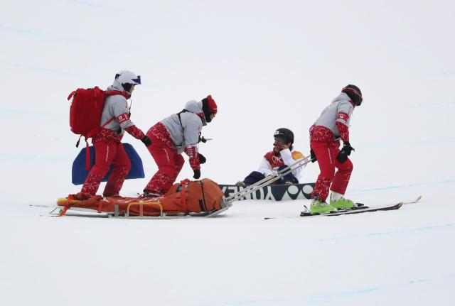 <p>Yuto Totsuka of Japan had a bad crash during his third run and had to be assisted by medical staff. REUTERS/Mike Blake </p>