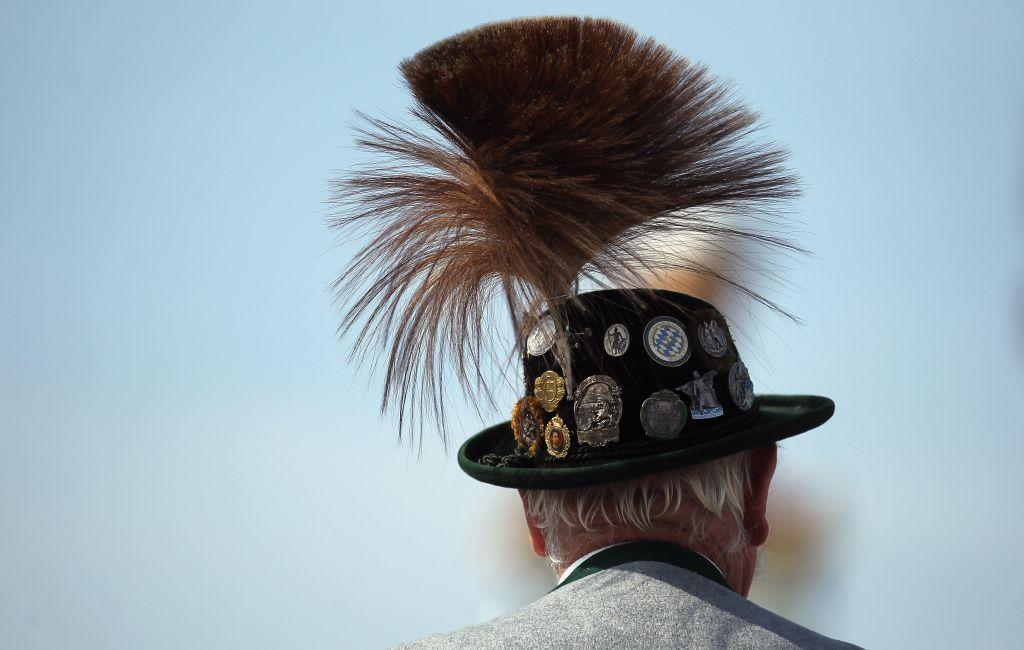 A member of a riflemen's association wears a traditional Bavarian Gamsbart hat.
