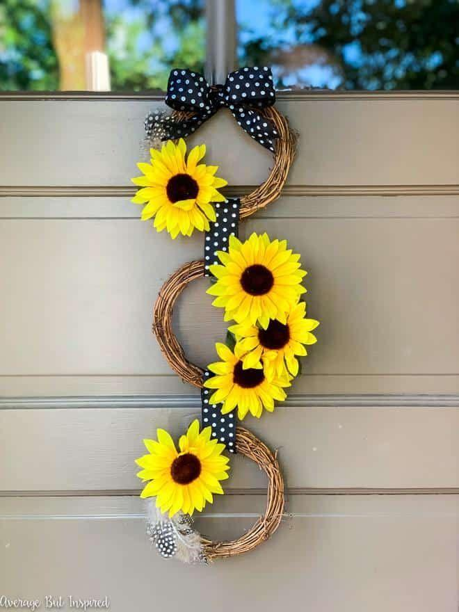 "<p>For a multi-wreath front door decoration, try this beautiful sunflower craft that can go from summer to fall.</p><p><strong>Get the tutorial at <a href=""https://averageinspired.com/2019/08/diy-dollar-tree-sunflower-wreath-perfect-end-of-summer-door-decor.html"" rel=""nofollow noopener"" target=""_blank"" data-ylk=""slk:Average but Inspired"" class=""link rapid-noclick-resp"">Average but Inspired</a>.</strong></p><p><strong><a class=""link rapid-noclick-resp"" href=""https://www.amazon.com/Juvale-Artificial-Sunflowers-Bunches-Sunflower/dp/B07CN1DZQJ/?tag=syn-yahoo-20&ascsubtag=%5Bartid%7C10050.g.4395%5Bsrc%7Cyahoo-us"" rel=""nofollow noopener"" target=""_blank"" data-ylk=""slk:SHOP ARTIFICIAL SUNFLOWERS"">SHOP ARTIFICIAL SUNFLOWERS</a><br></strong></p>"