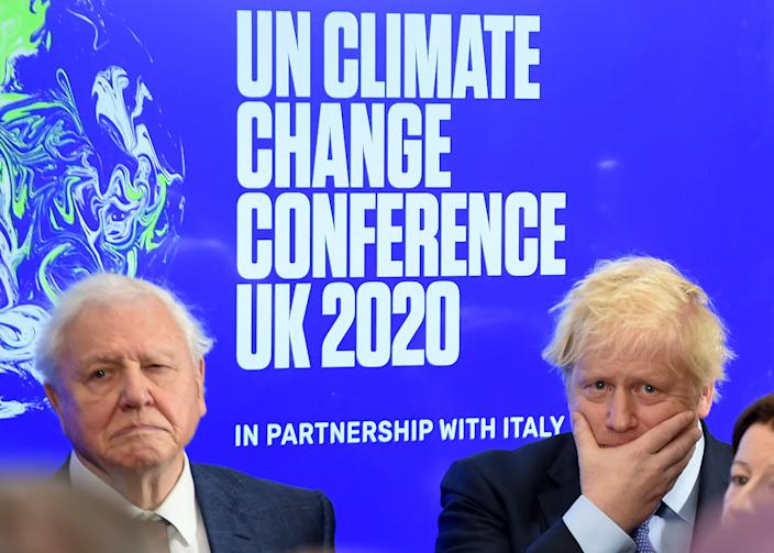 Britain's Prime Minister Boris Johnson (R) and British broadcaster and conservationist David Attenborough attend an event to launch the United Nations' Climate Change conference, COP26, in central London on February 4, 2020. - Britain will bring forward a ban on sales of new petrol and diesel vehicles to 2035, including hybrids, Prime Minister Boris Johnson was to announce on Tuesday. Johnson was to make the announcement at an event launching the 2019 United Nations Climate Change conference, COP26, which will be held in Glasgow in November. (Photo by Jeremy Selwyn / POOL / AFP) (Photo by JEREMY SELWYN/POOL/AFP via Getty Images)