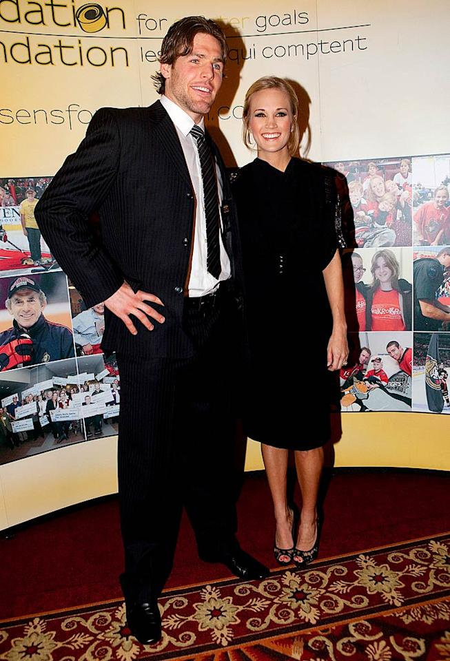 "Country star Carrie Underwood and her fiance, hockey player Mike Fisher, made their first official red carpet appearance Monday night at the annual Sens' Soiree fundraiser in Quebec. It was also announced this week that the future Mrs. Carrie Fisher (ha!) will sing the national anthem at the Super Bowl this year. Christopher Pike/<a href=""http://www.splashnewsonline.com"" target=""new"">Splash News</a> - January 25, 2010"