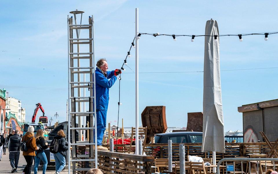 Lights go up in the seaside resort of Brighton as businesses prepare to reopen on Monday - Simon Dack/Alamy Live News