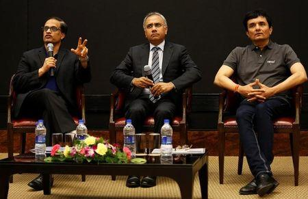 (L-R) Infosys' Chief Operating Officer Pravin Rao, Chief Executive Officer Salil S. Parekh, and Chief Financial Officer Ranganath D. Mavinakere address the media during the announcement of the company's quarterly results at its headquarters in Bengaluru, India, January 12, 2018. REUTERS/Abhishek N. Chinnappa
